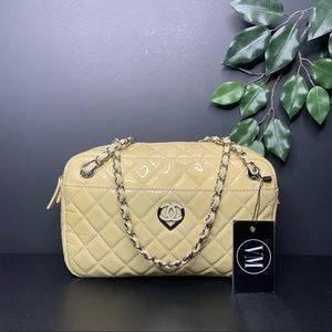 CHANEL • QUILTED PATENT LEATHER BAG